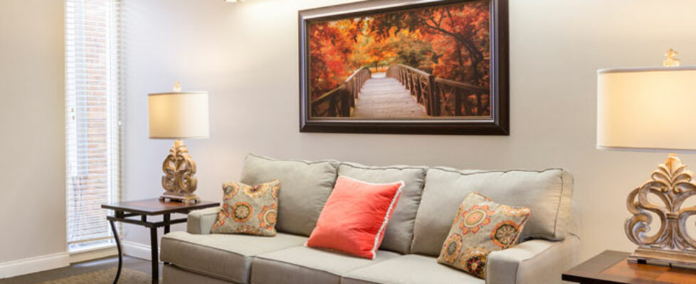 Plush couch with end-tables, and wall art