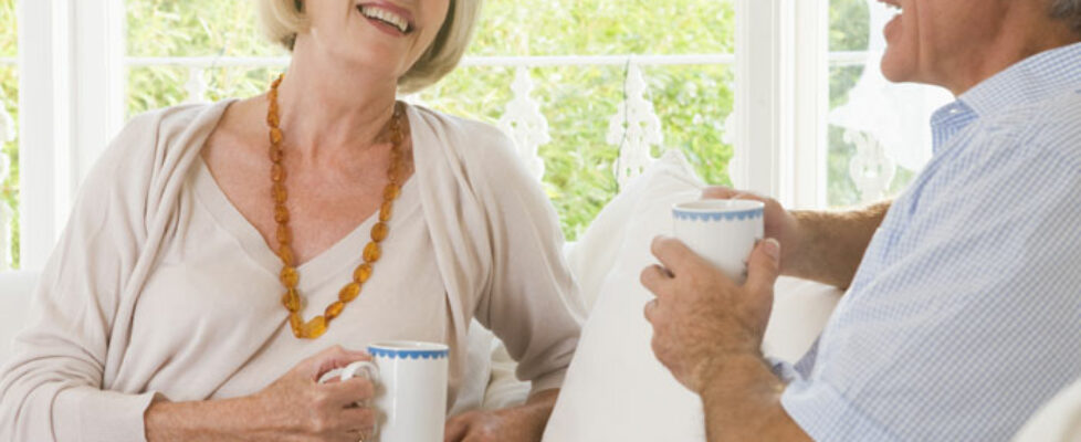 Couple talking and enjoying coffee