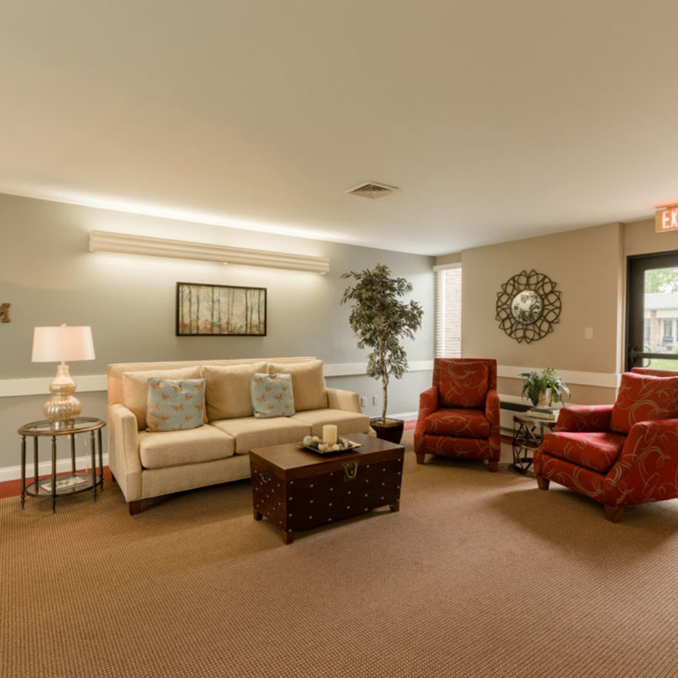 Common area with plush couch and chairs