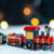 The Christmas train in the snow on bokeh background